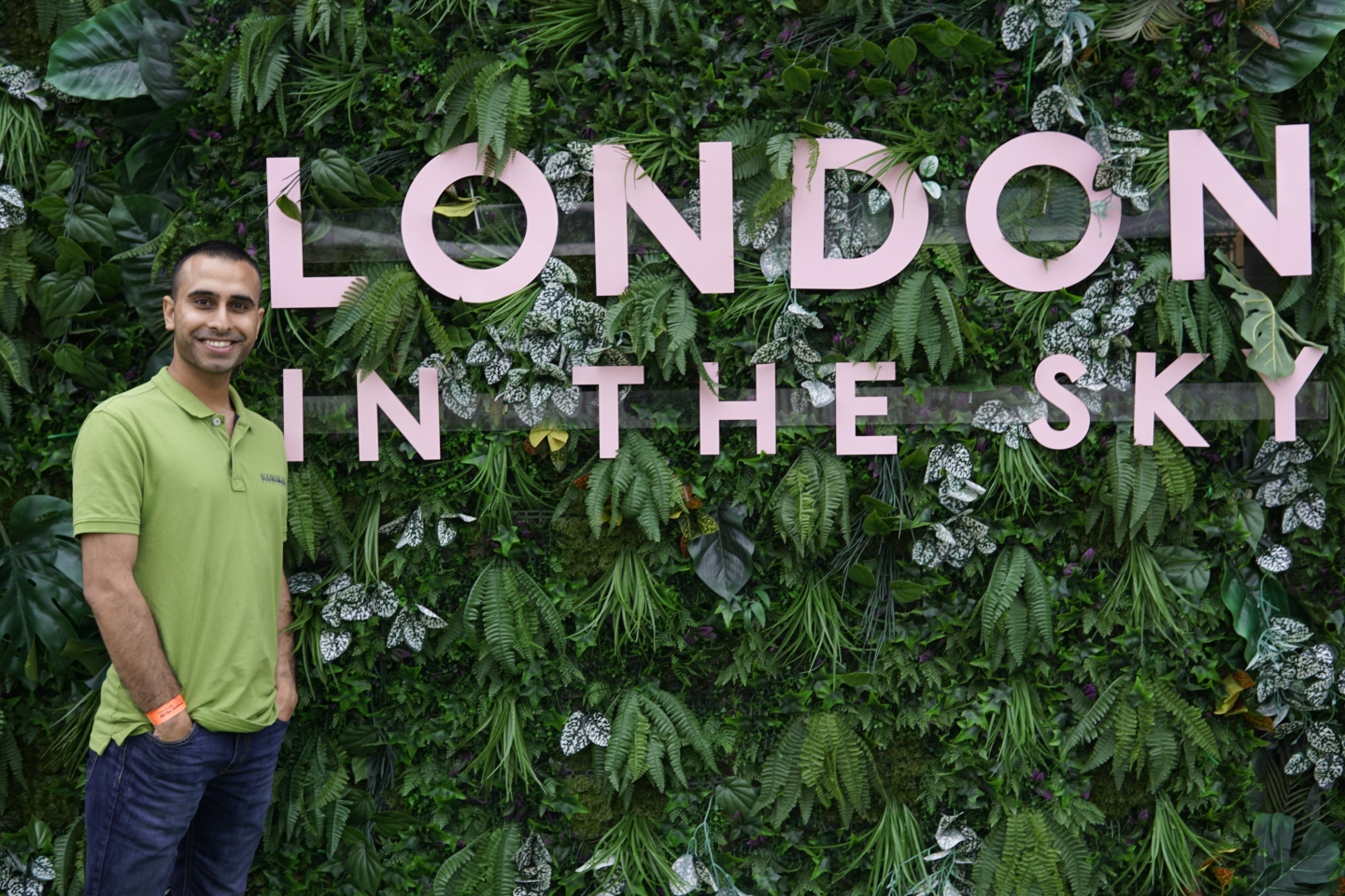 Adil Musa alongside the London in the Sky Sign